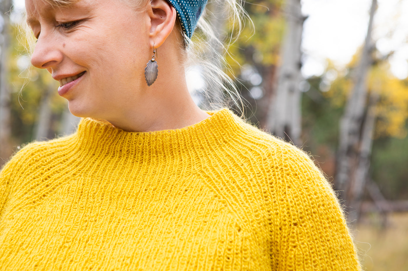 This is a detail shot of Amber and her yellow sweater's neckline.