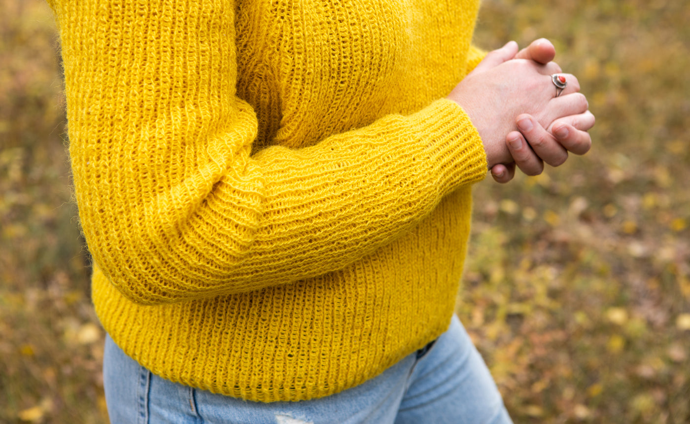 This is sleeve detail of Amber's yellow sweater.