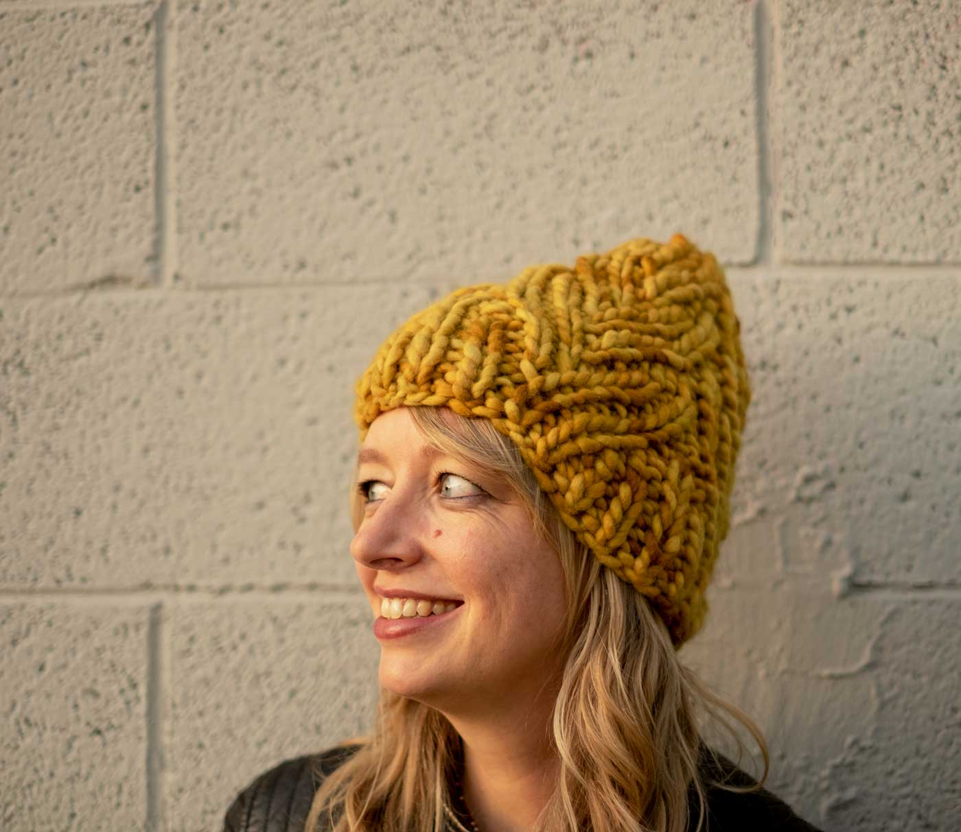 Amber in her mustard Neighborhood Holiday Hat