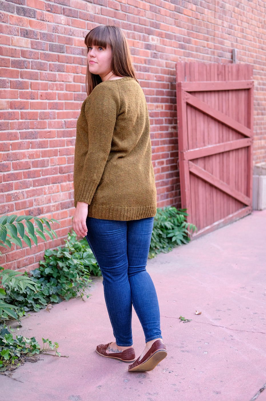 Back View of the Long Fingering Weight Uniform Cardigan