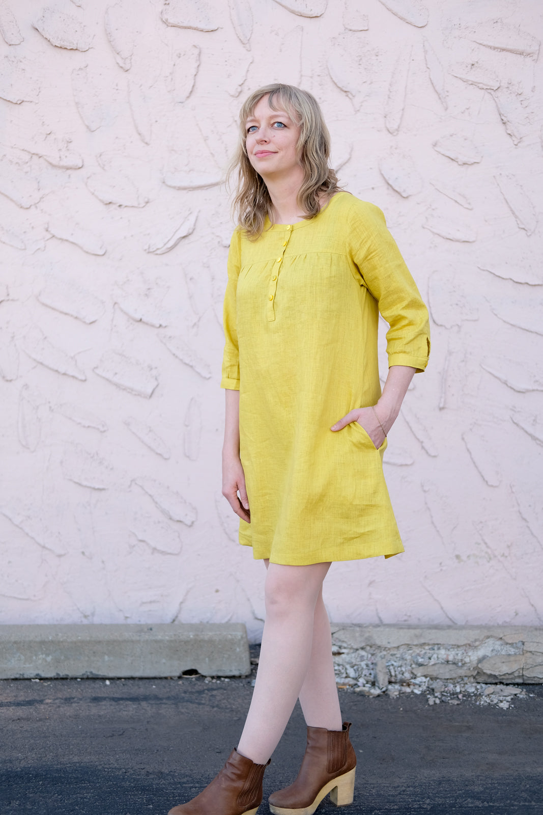 Amber in her citrus colored linen Brome with her hand in the pocket