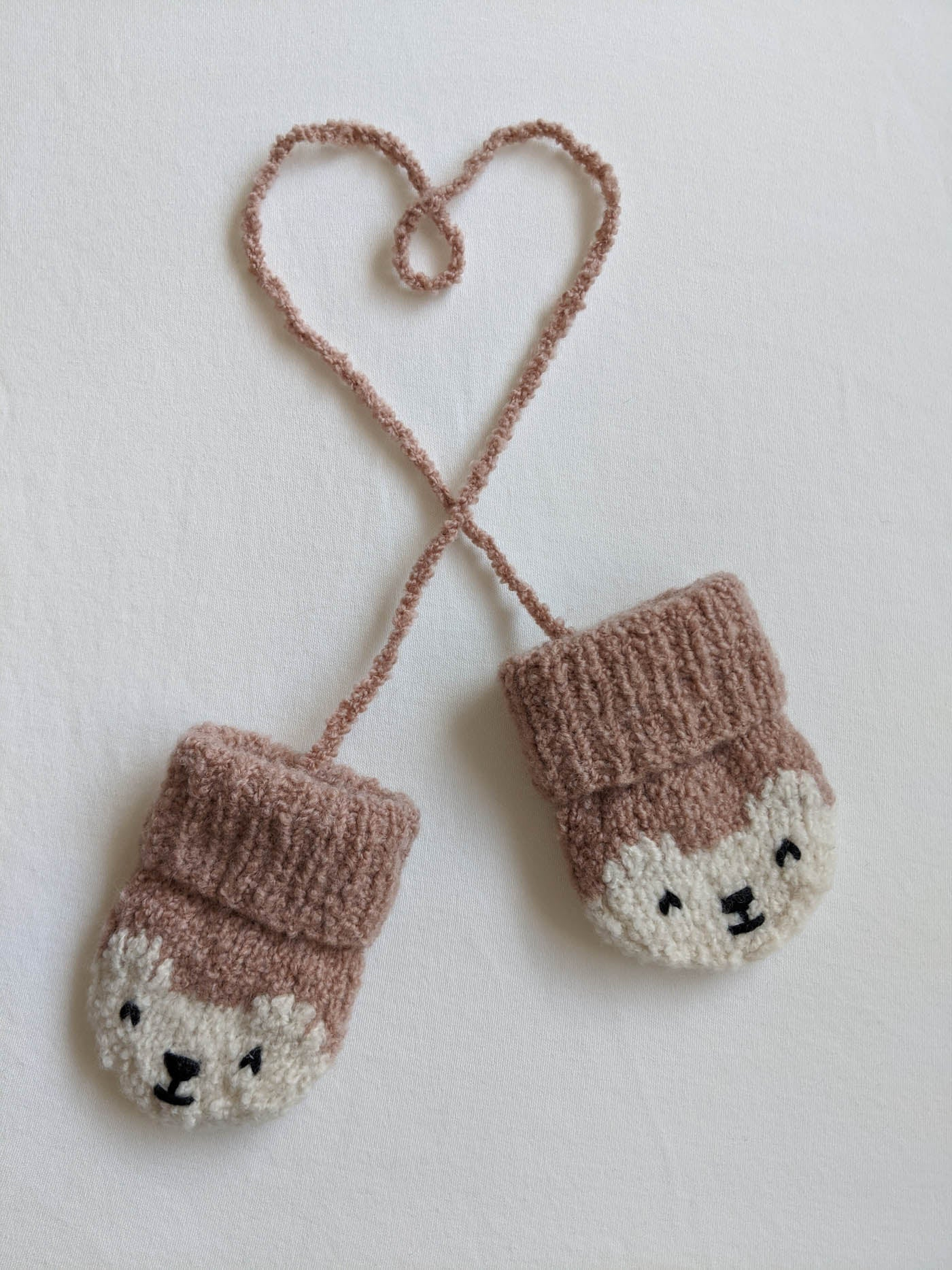 Baby mittens with cord