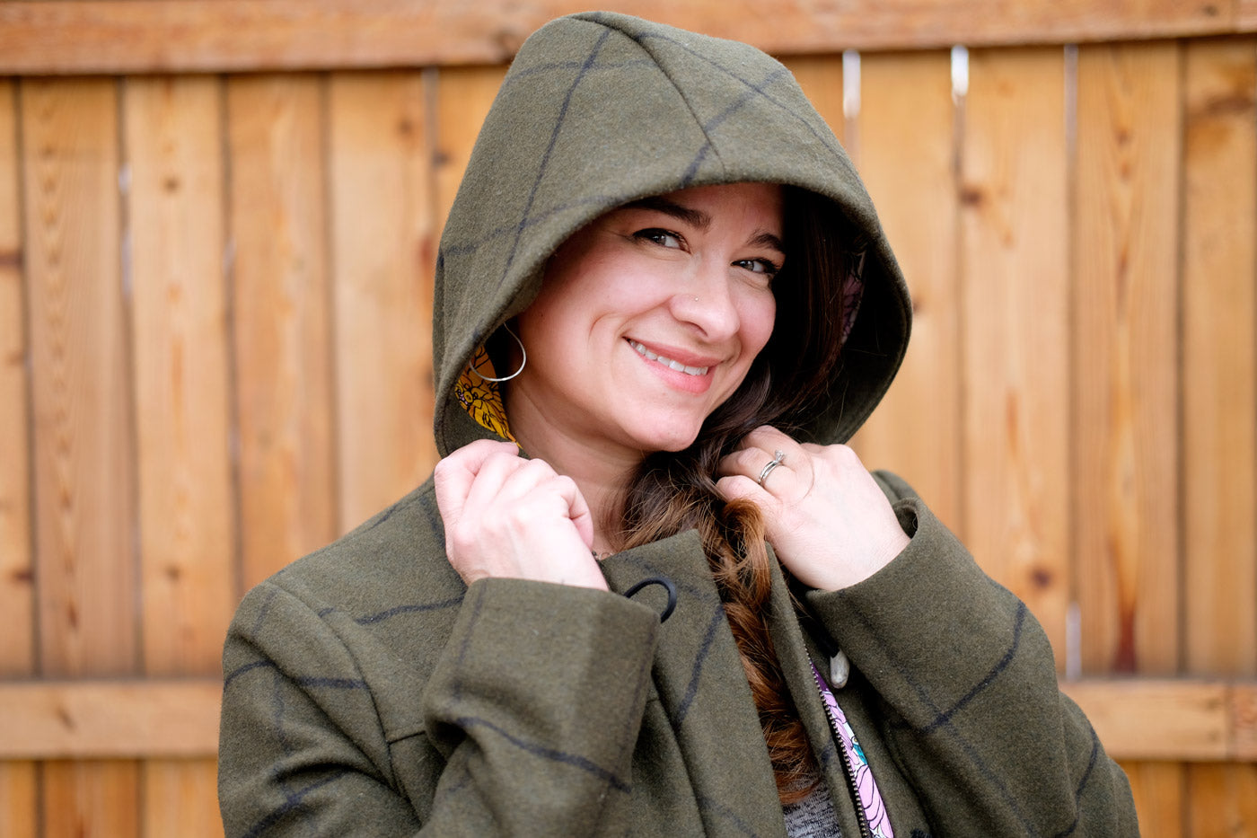 Tiffani wearing the hood of her Cascade Duffle Coat