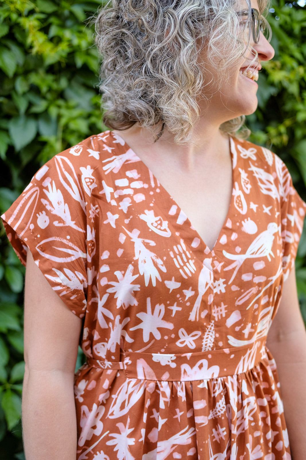 Neckline and Placket detail on Jaime's burnt orange Caftan