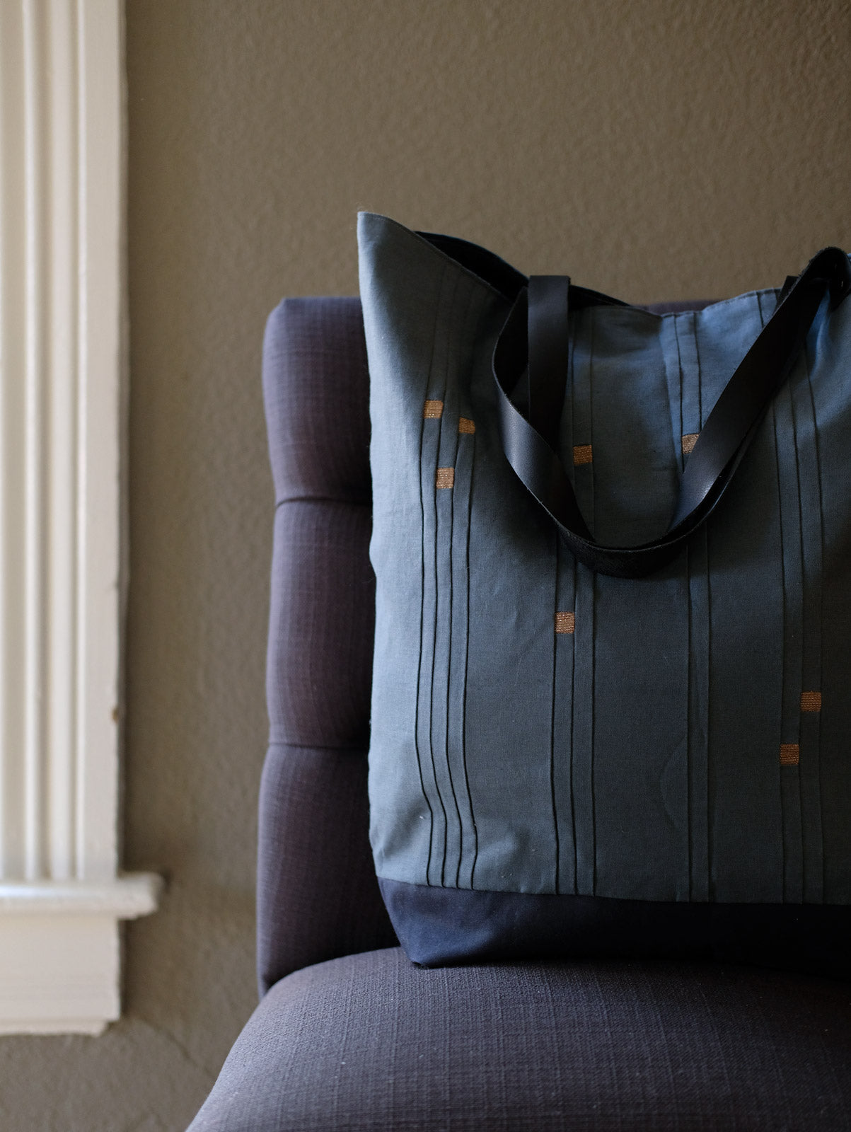 Constellations Star Sign Tote sitting on a chair near a window