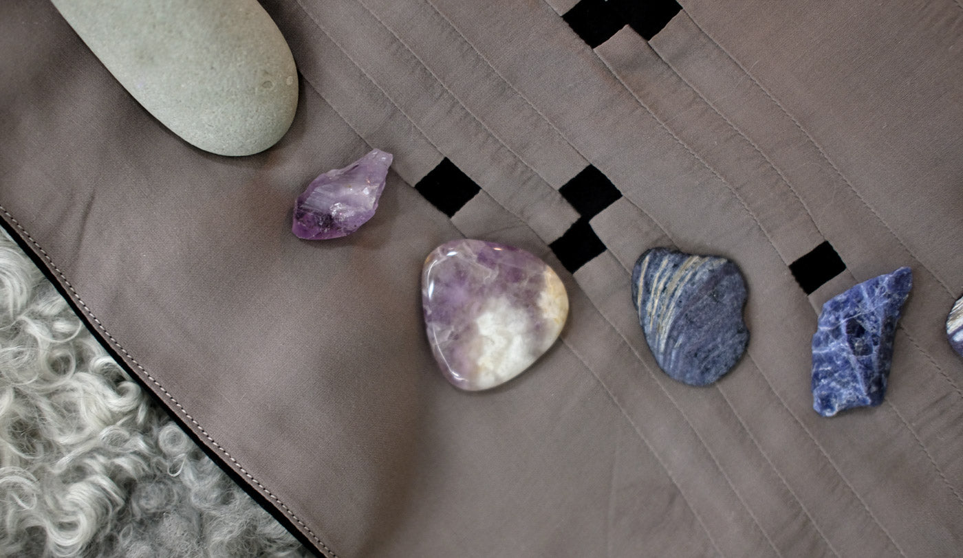 Taupe side of the Constellations Tarot Cloth with stones