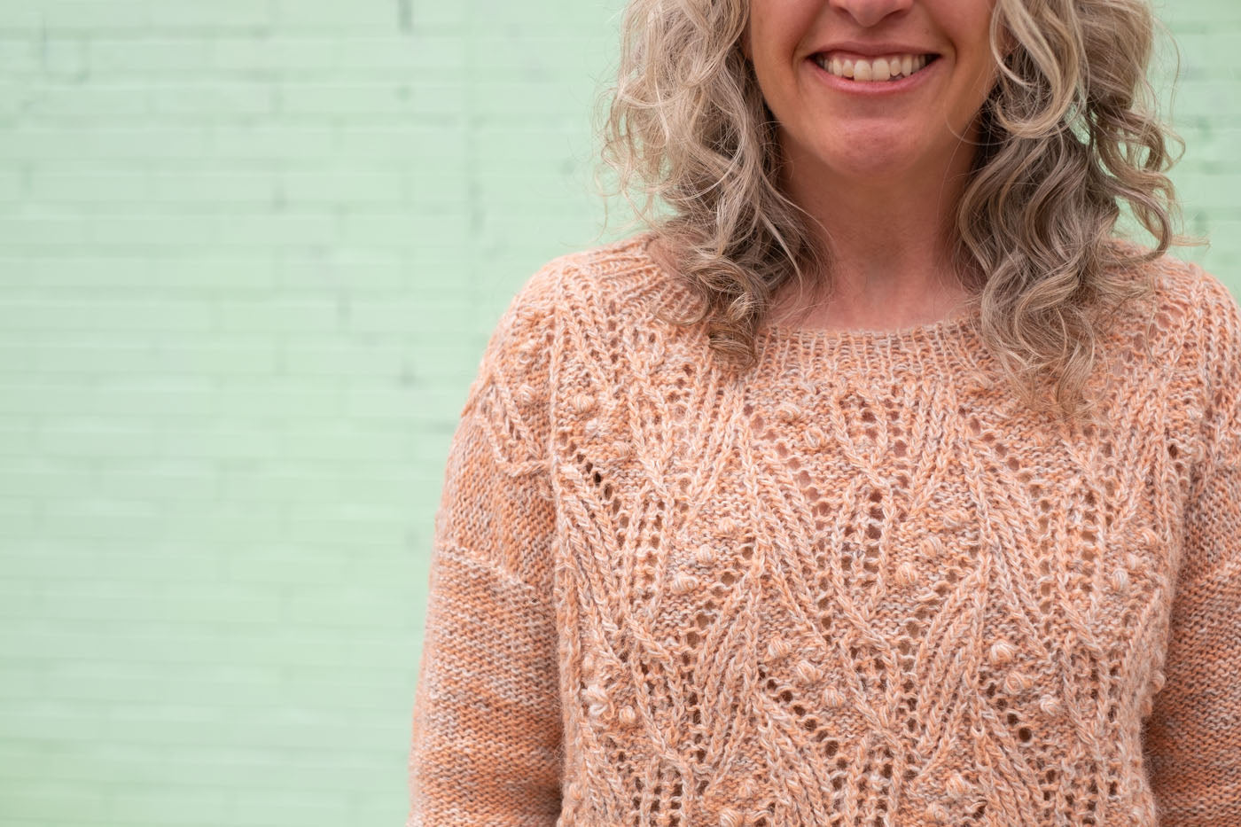 A detail shot of the texture on Jaime's sweater, showing the lace, bobble and cable texture.