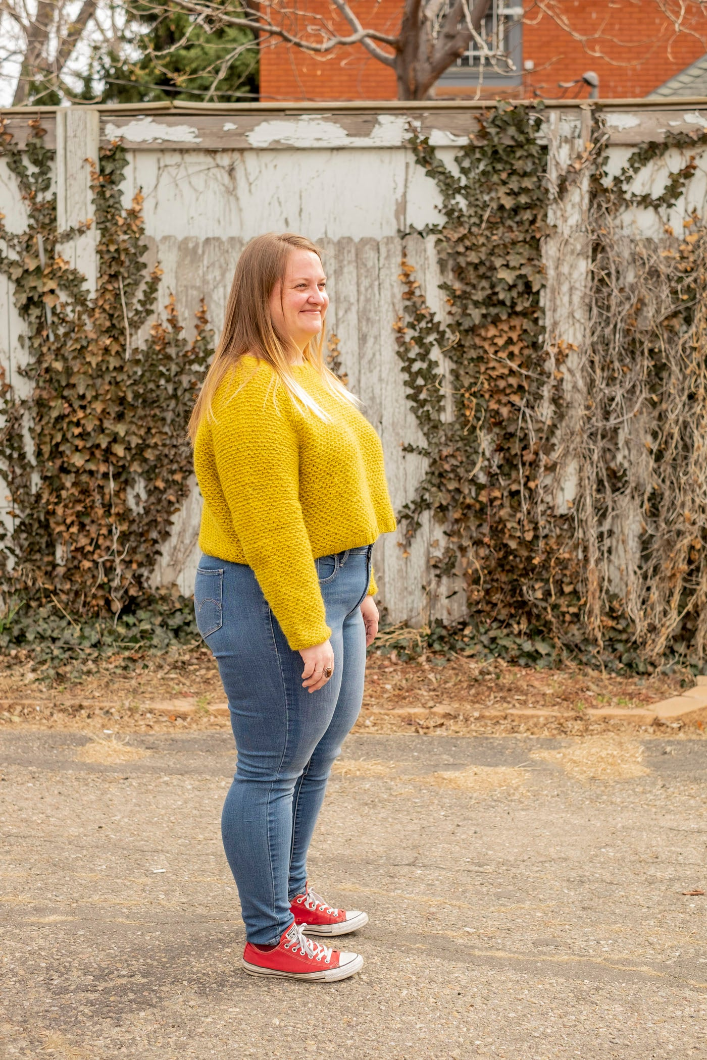 Sideview of Shawna's cropped nurtured sweater