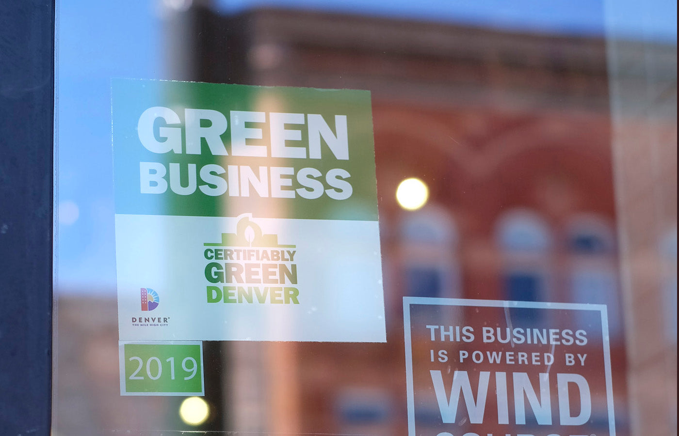 green business decal on store front