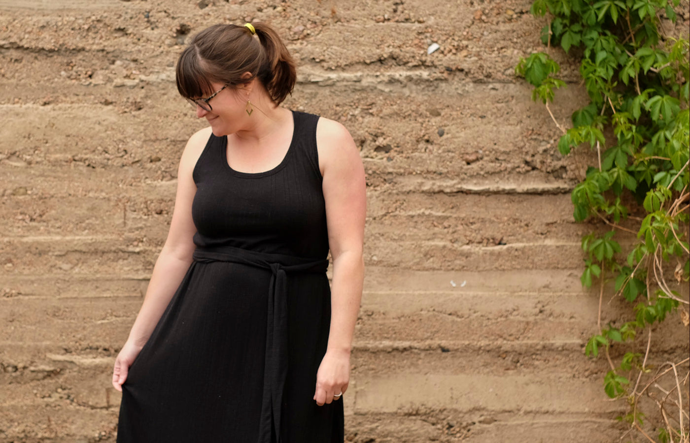 Amanda's black racerback maxi dress with a self fabric tie