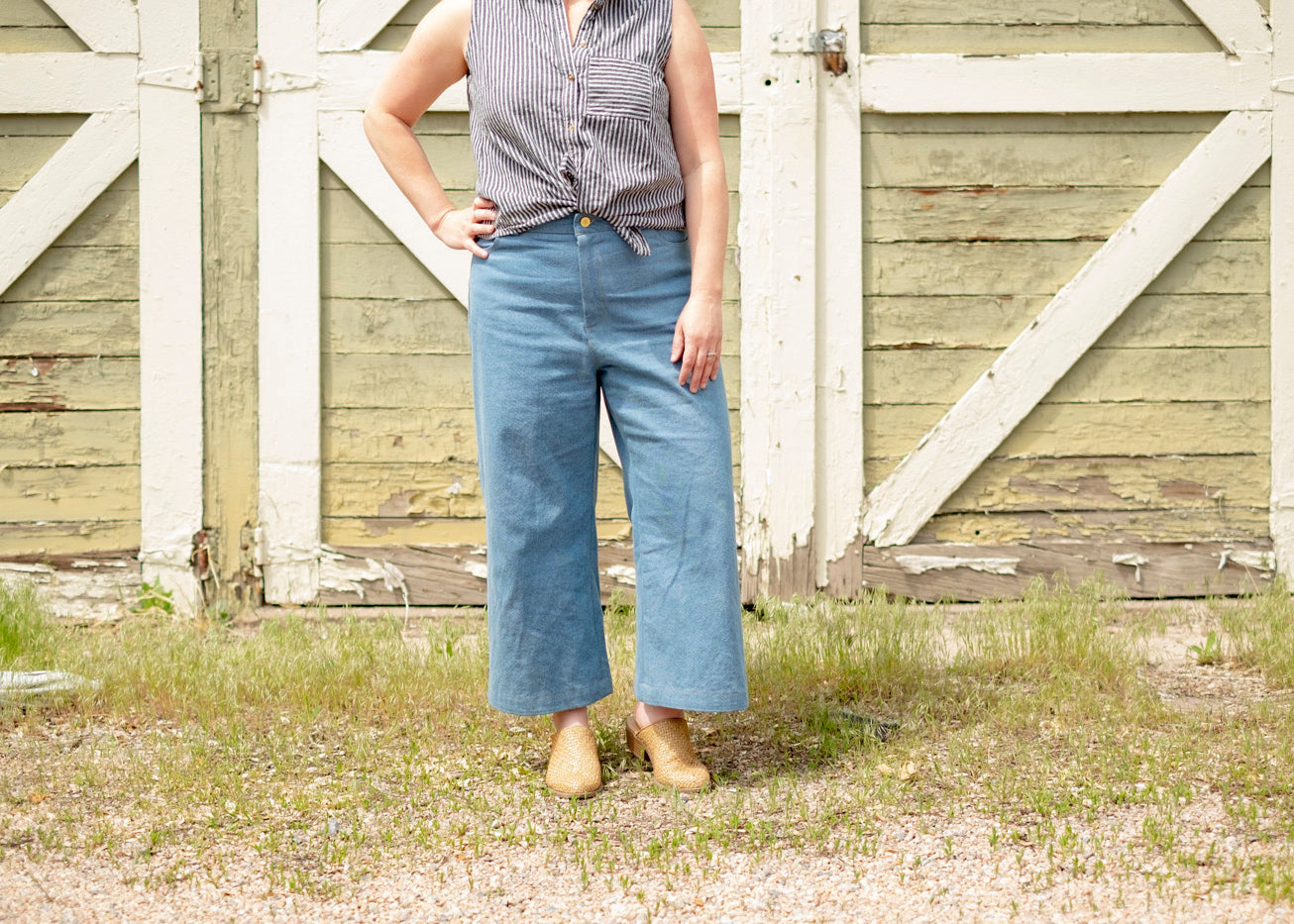 Amanda's lander pants in front of barn wall