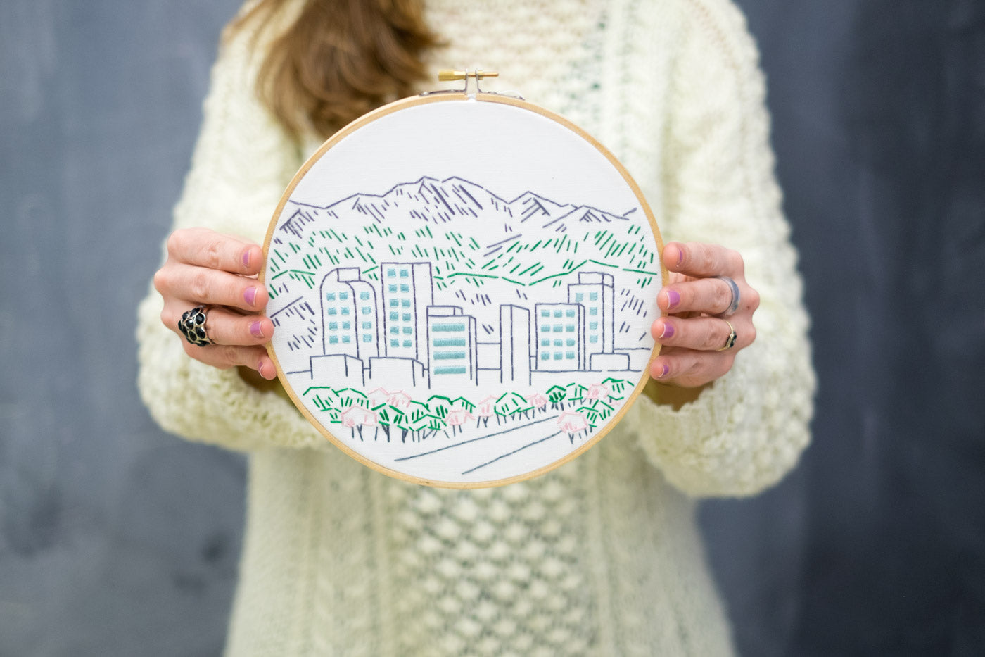 Kelly Holding Her Denver Skyline Embroidery