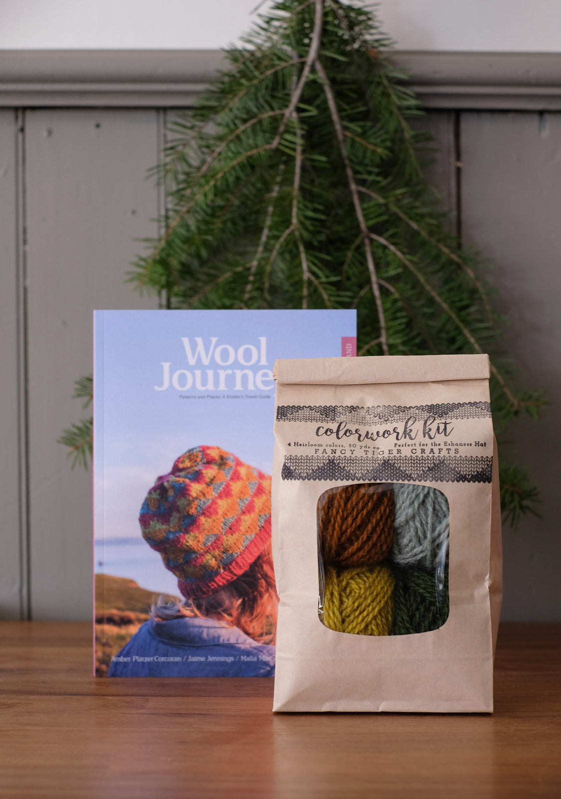 An Eshaness hat kit sitting in front of the Wool Journey: Shetland Book