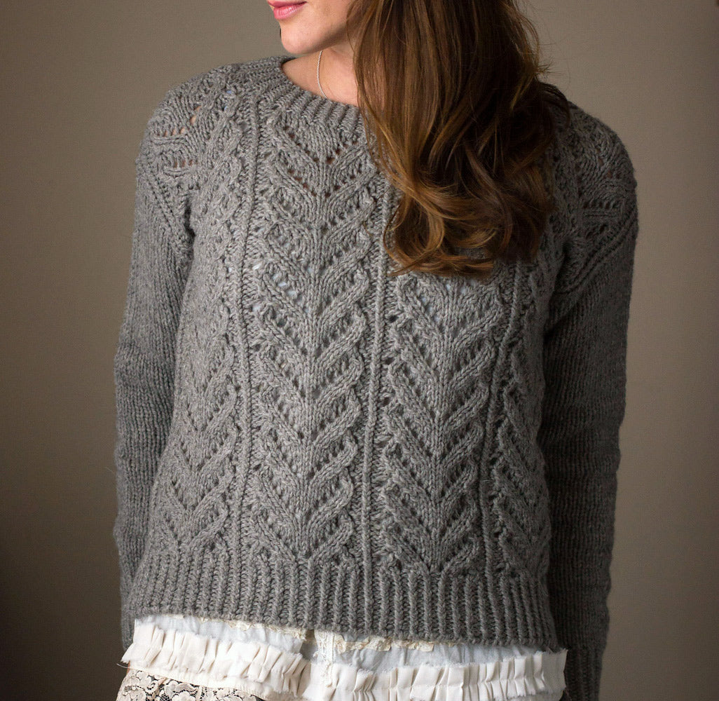 Close up of Wolf River sweater, a chunky lace sweater in grey wool