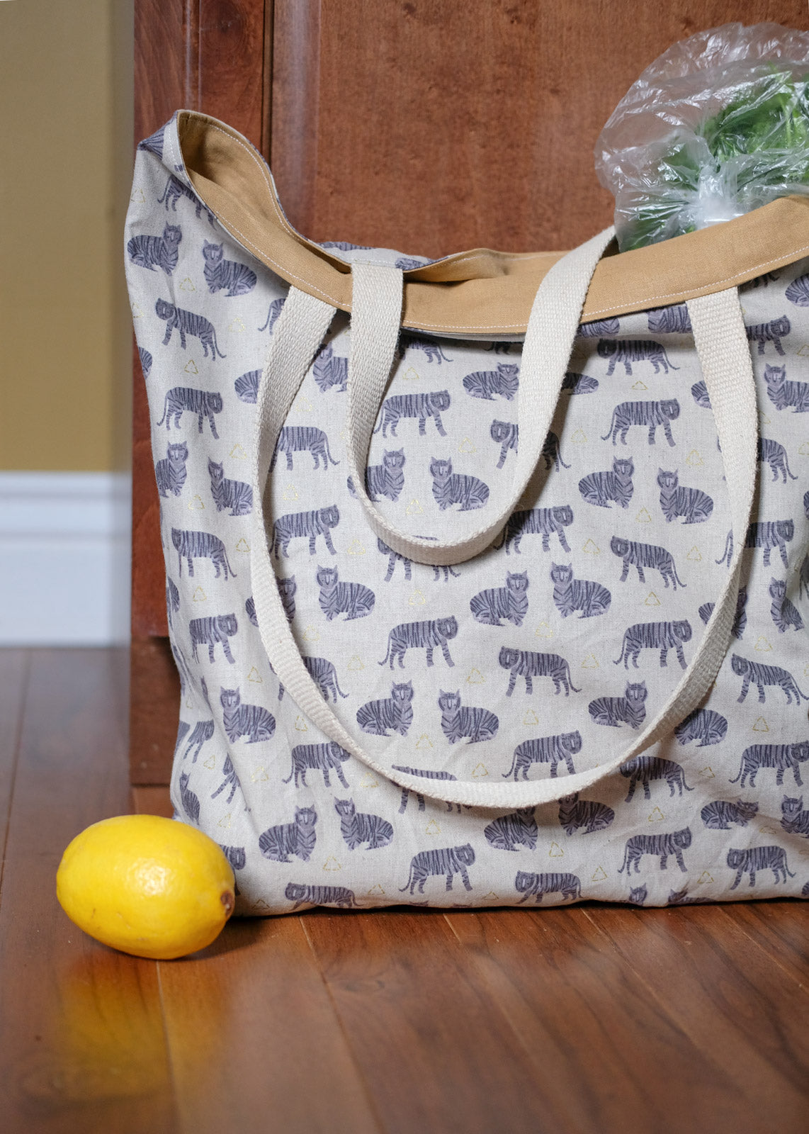 Fancy Tiger Crafts Market Tote sitting on the floor with a lemon in front
