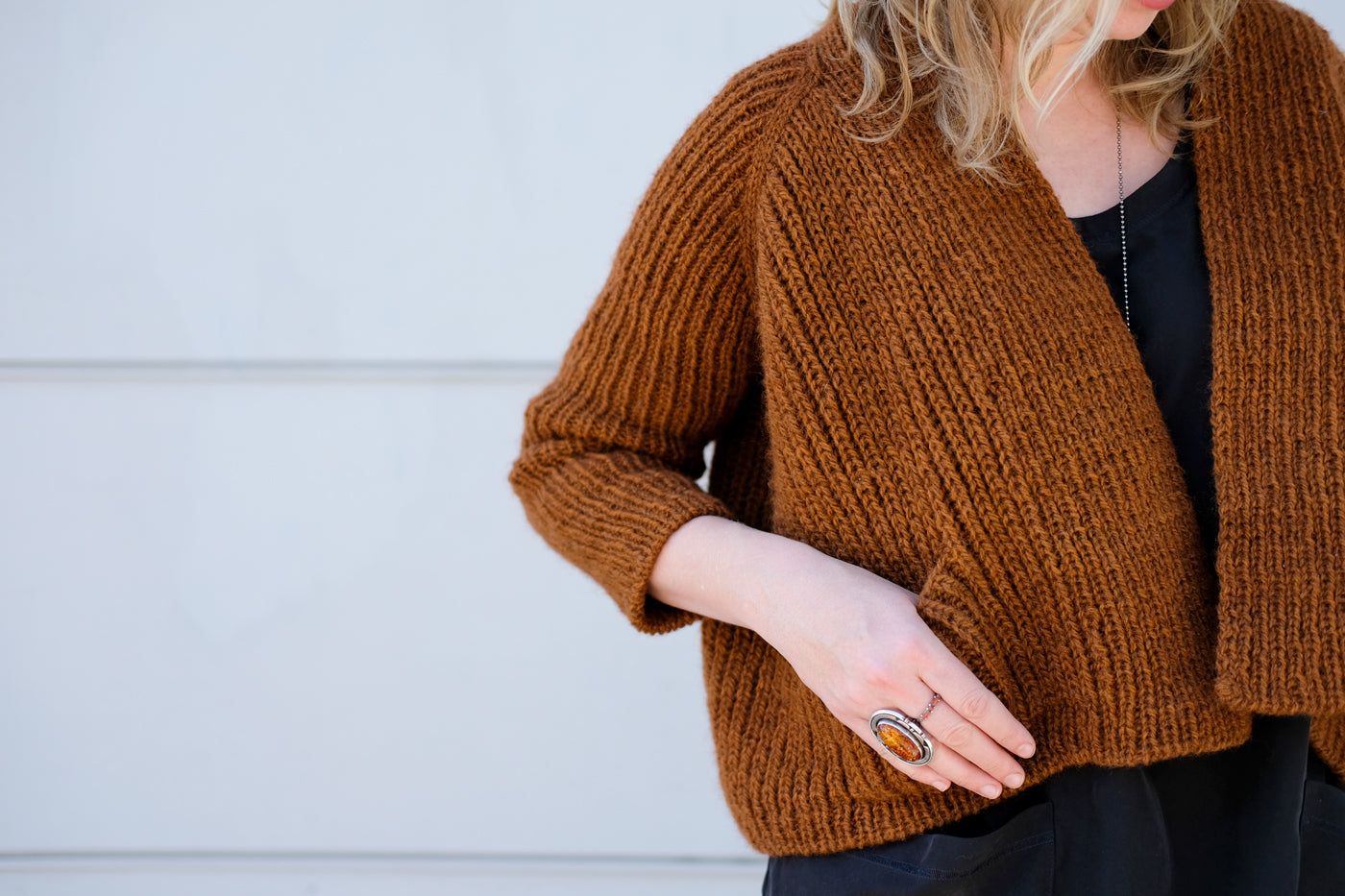 Tiny pocket detail for Amber's cropped sweater