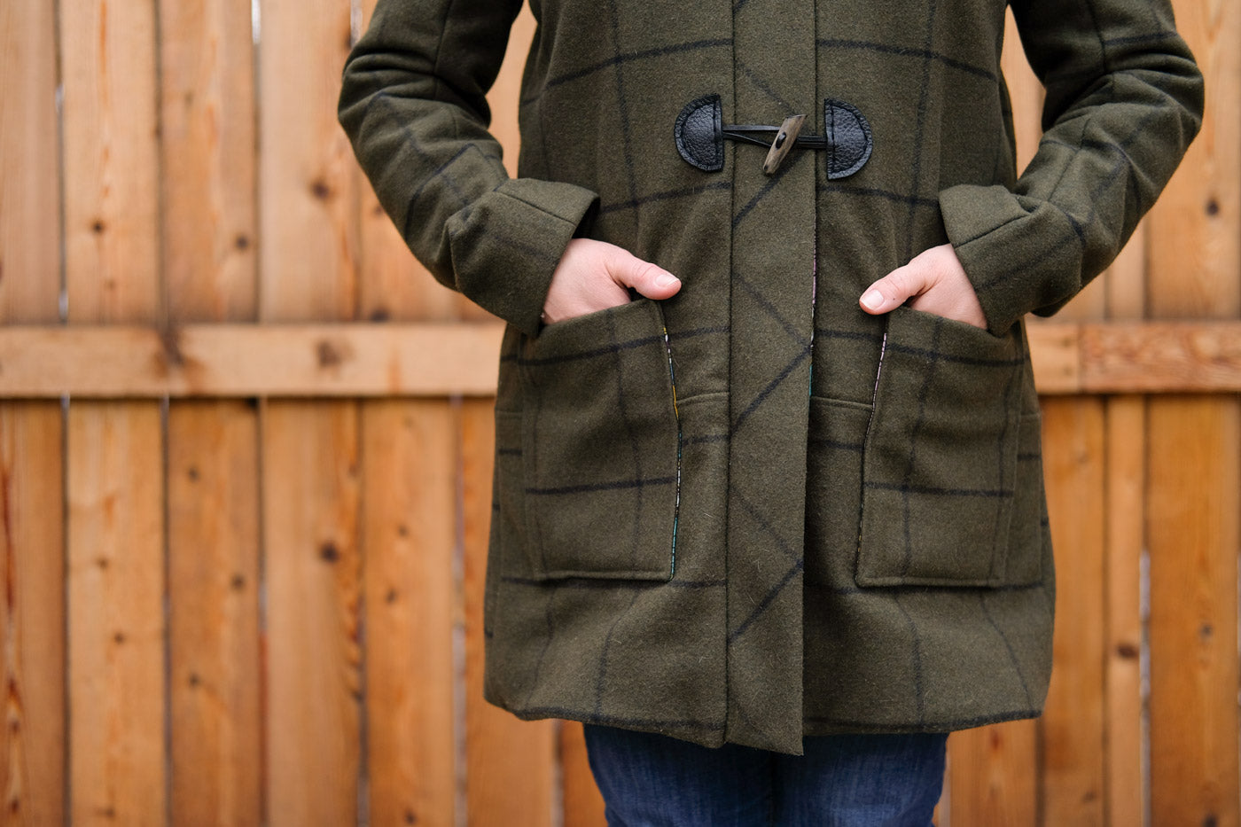 Hands in patch pockets of the Grainline Studio Cascade Duffle Coat