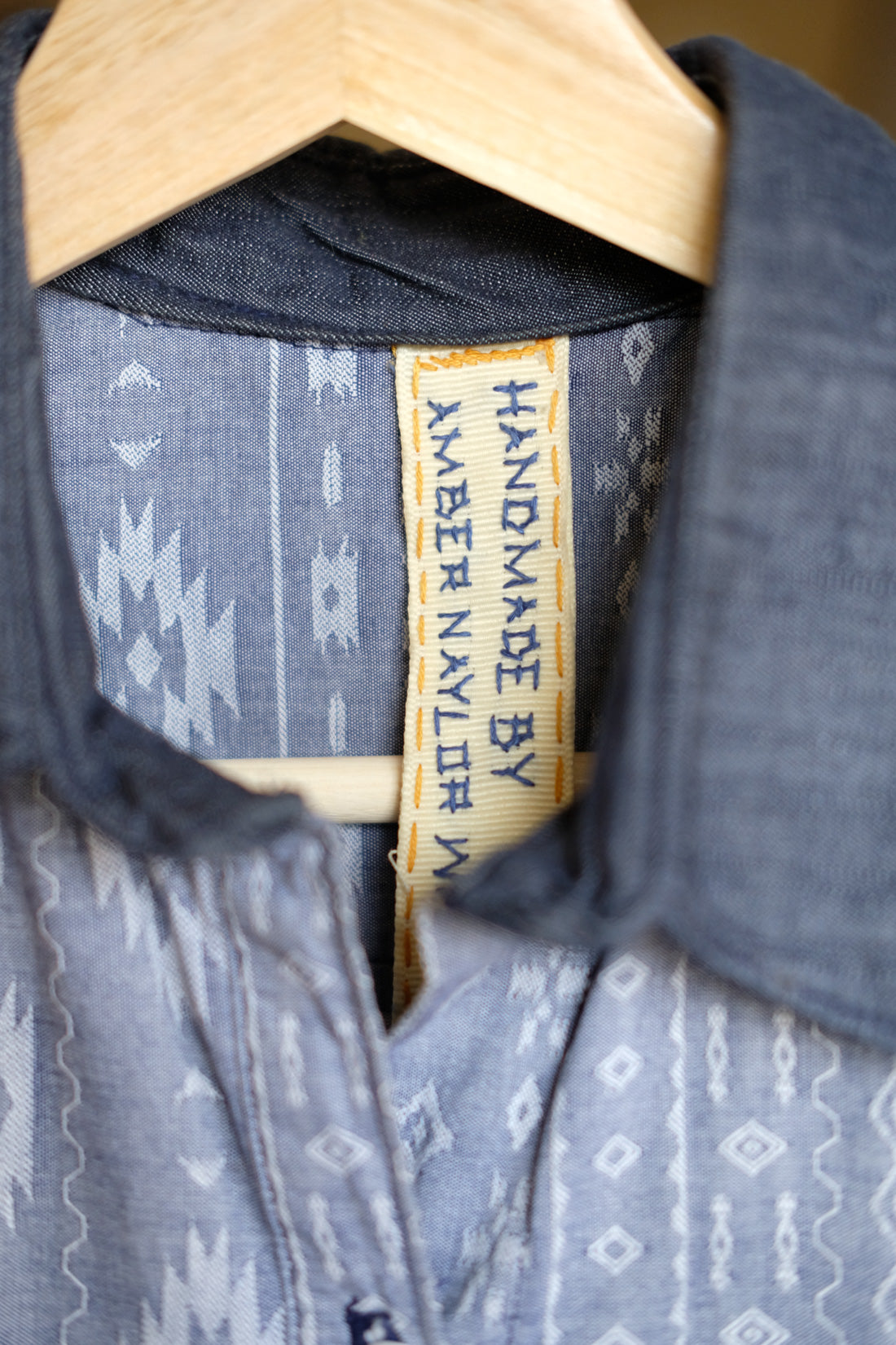 Hand-stitched clothing tag