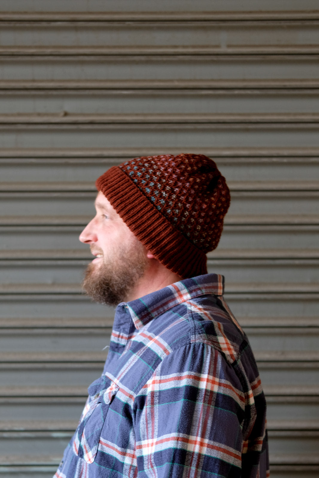 Side view of Scott's rusty red Honey Drudger hat
