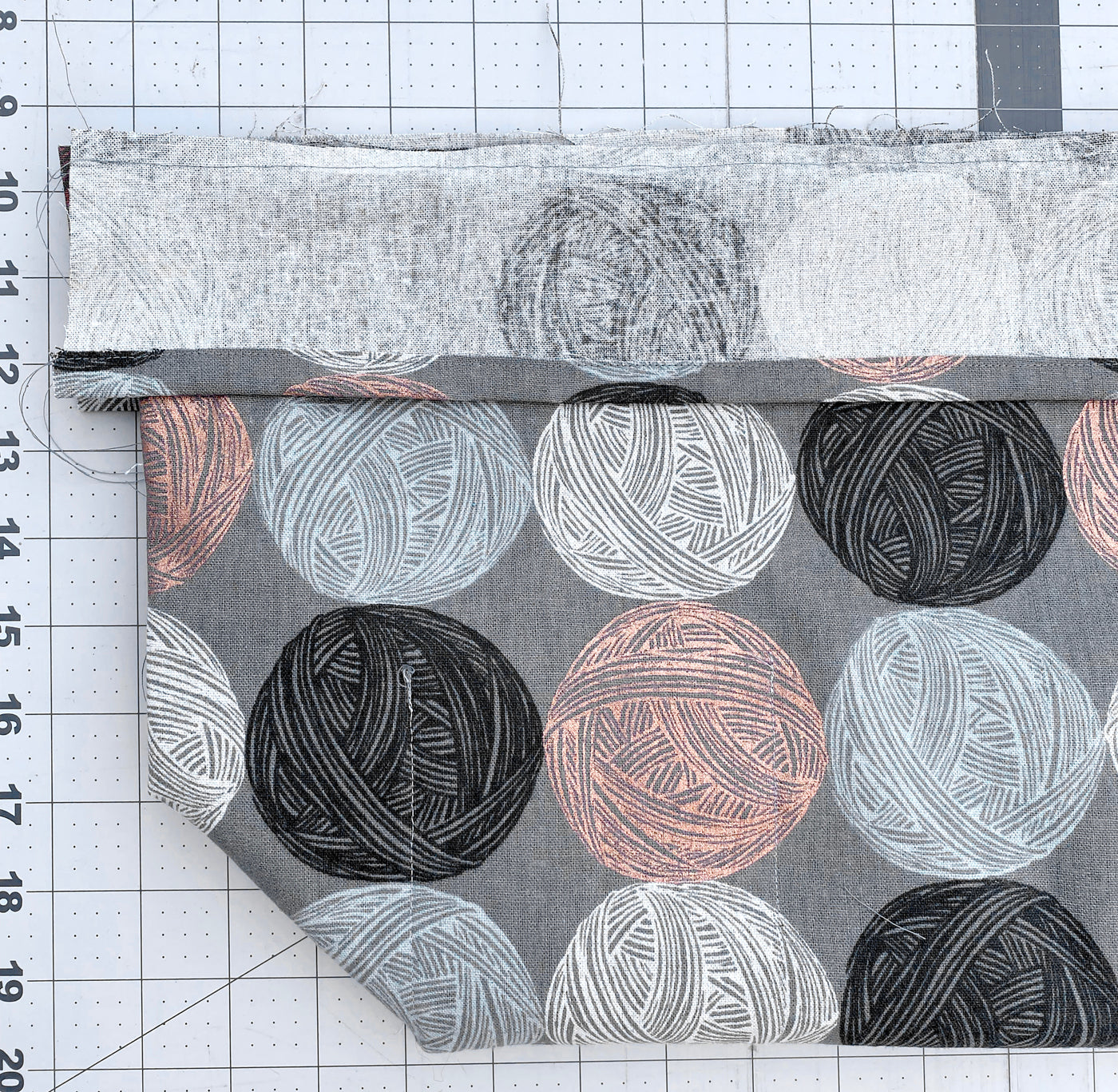 This is an image of a field bag being made, unfinished and laid on top of a cutting mat.