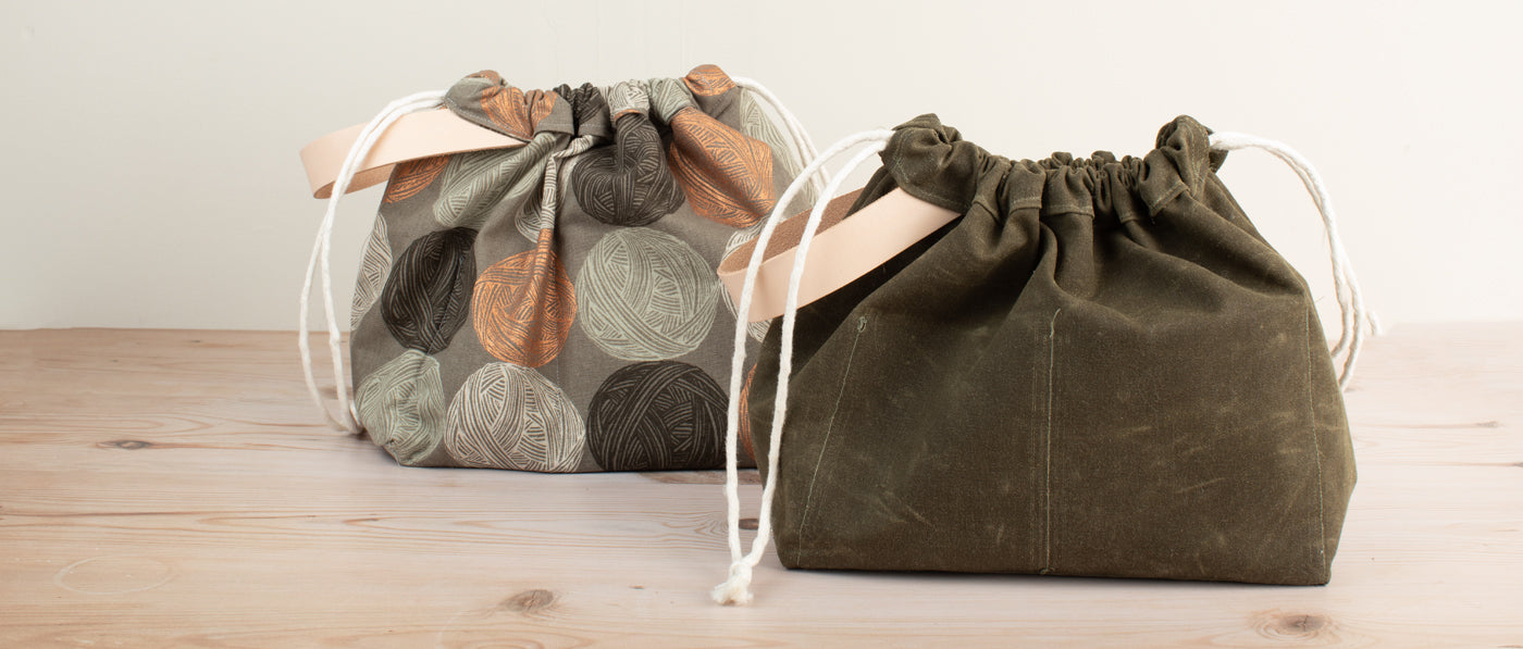 This is an image of two work bags side by side.