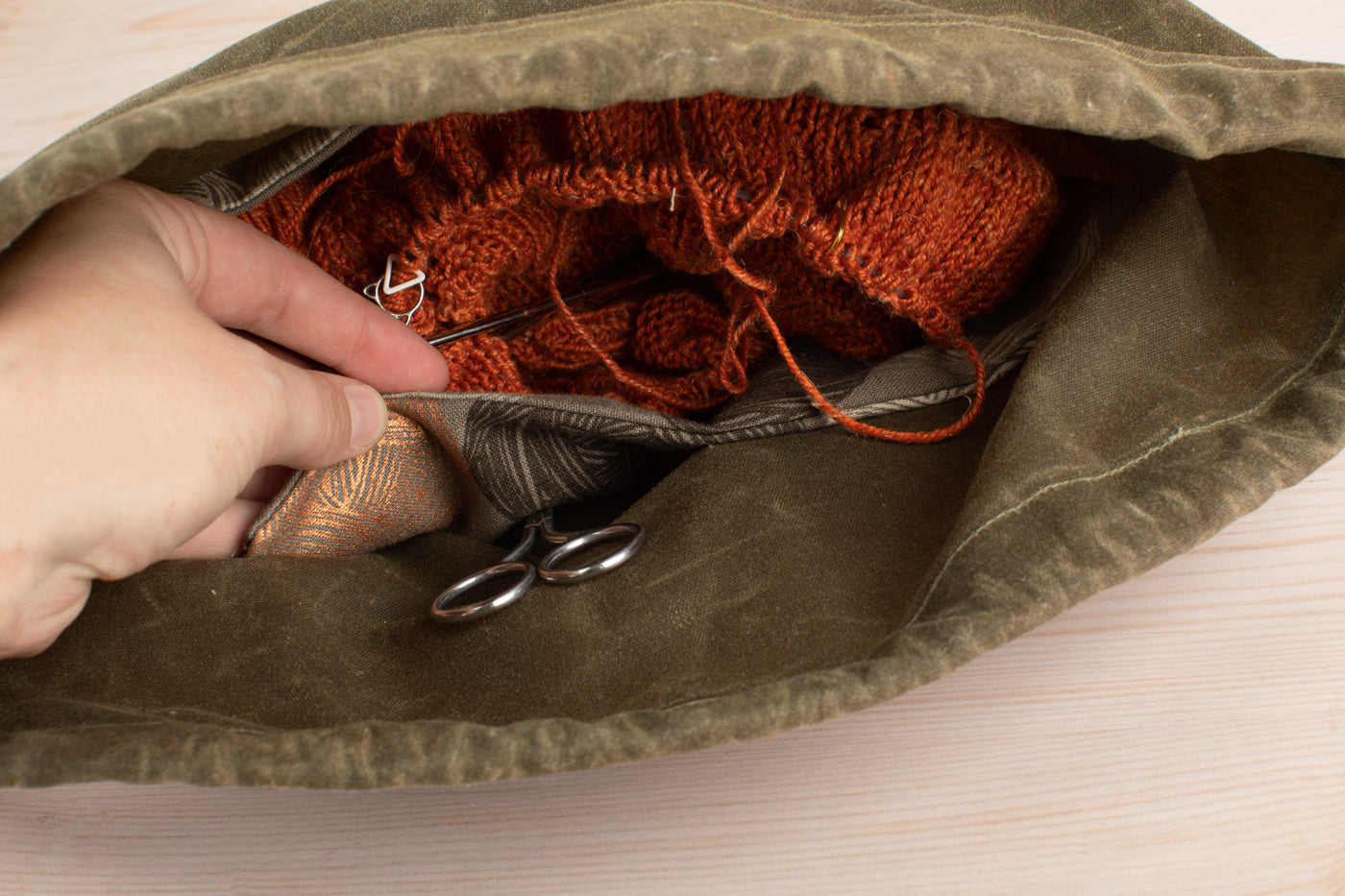 This is an image of the canvas bag with scissors and yarn inside of it.