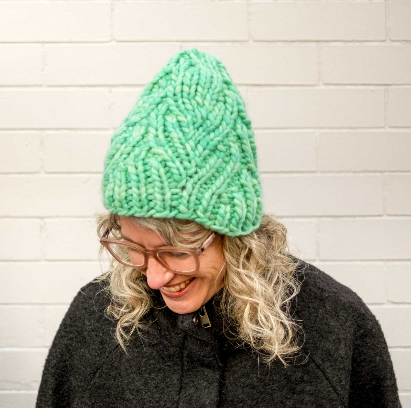 Jaime wearing her mint Neighborhood Holiday Hat