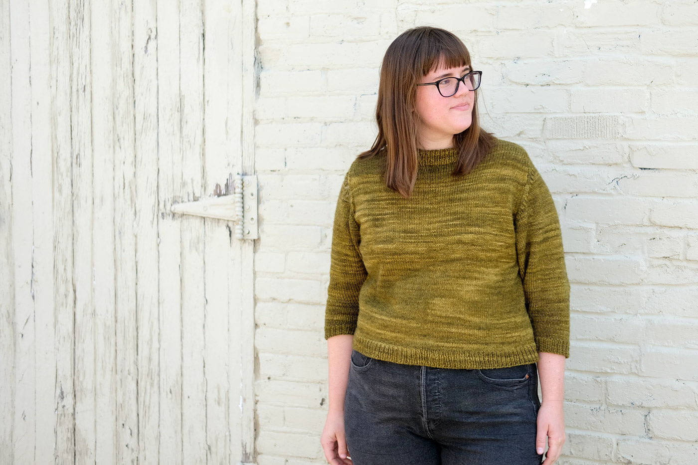 Kaylee Lockhart in her green-yellow MadelineTosh DK Cline Sweater