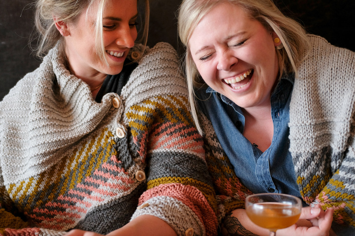 Kelly and Heather laughing in their Om Shawls