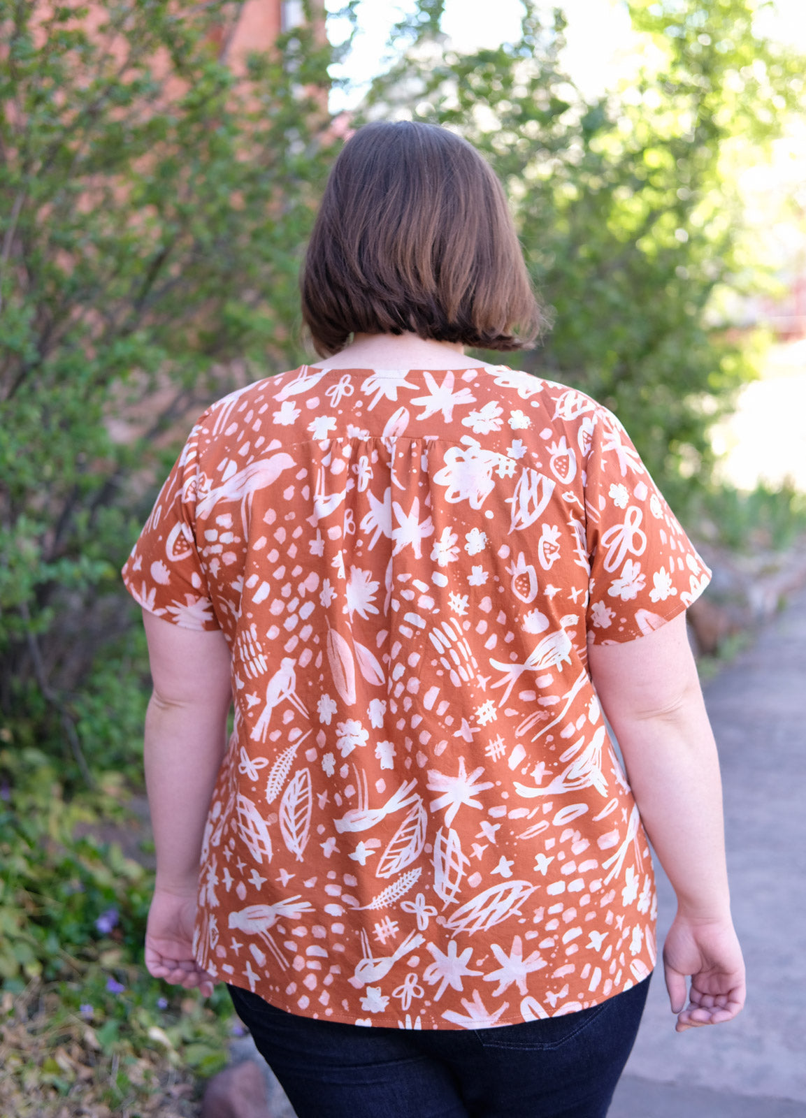 Back view of Caitlin in her burnt orange Montrose