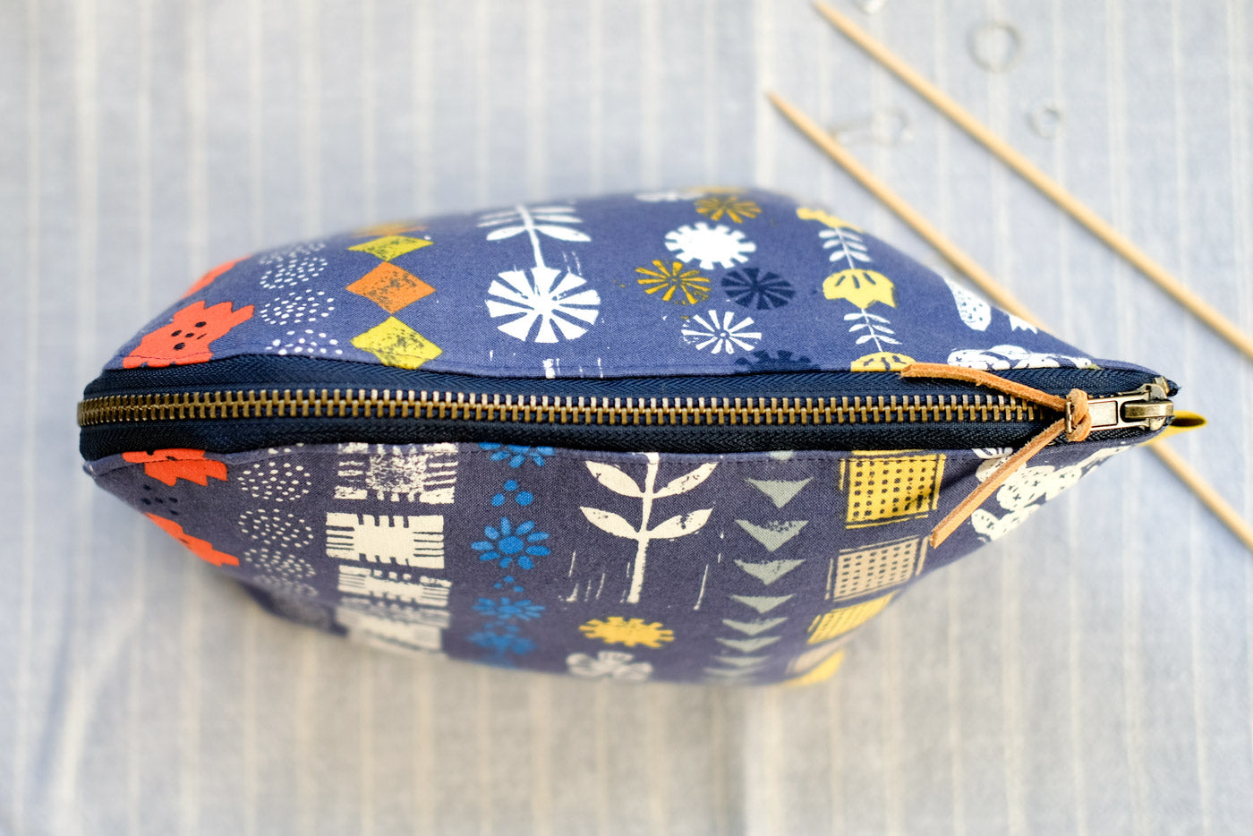 Closed, top-view of the Open Out Box Pouch by Aneela Hoey