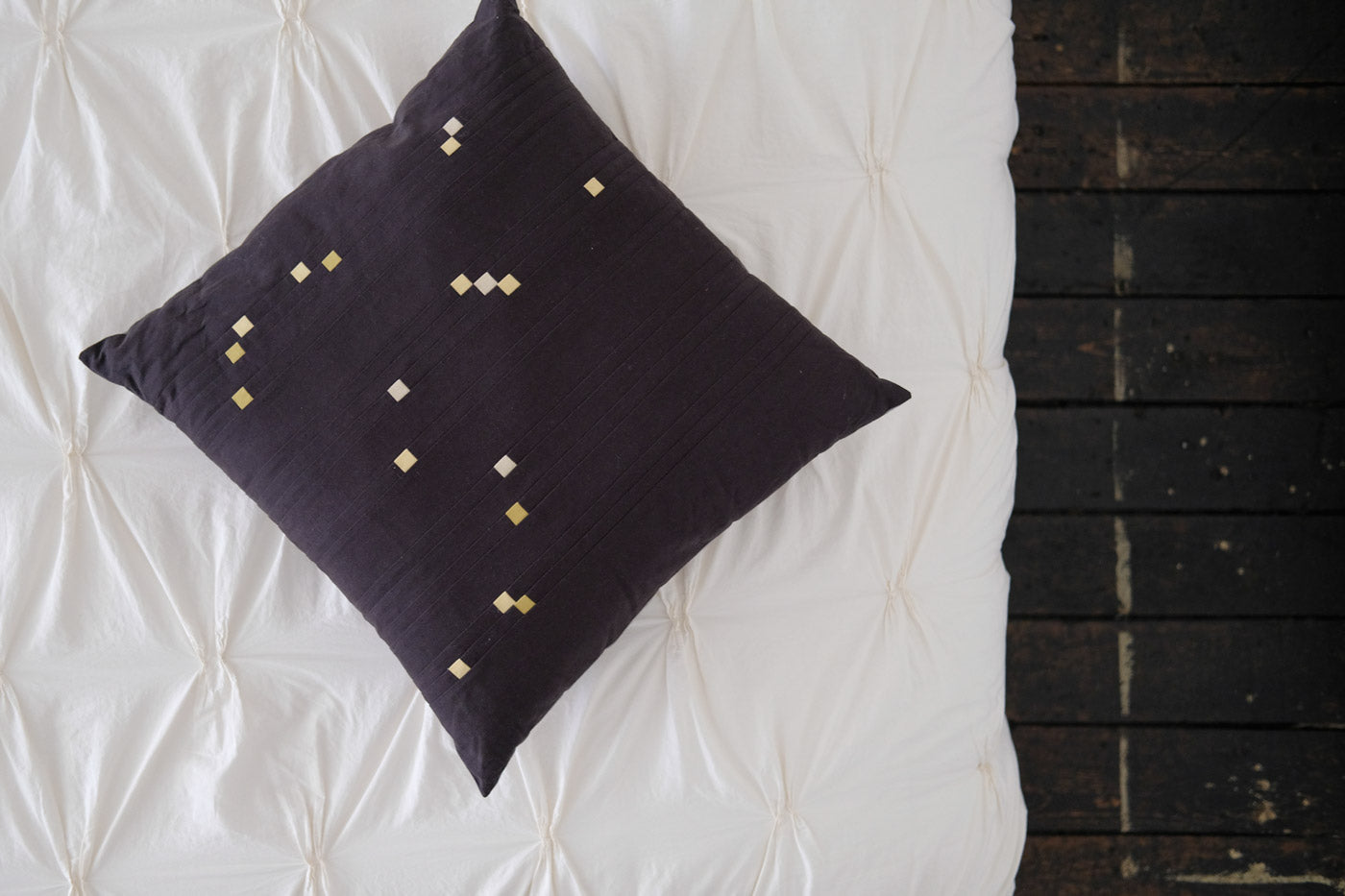 Orion Pillow on a white bed looking from above