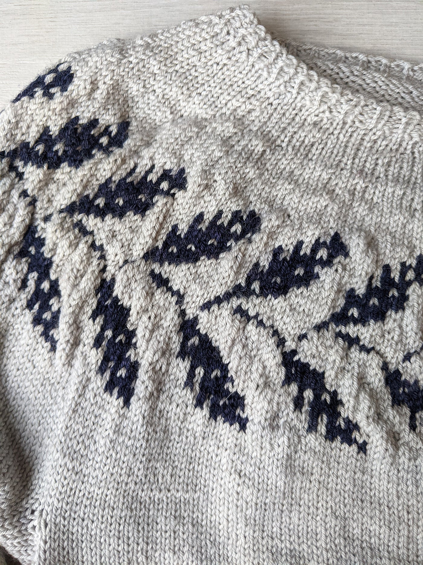 This is a detail shot of the intricate knit design along the collar of the sweater