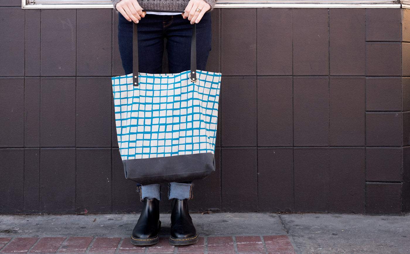 Hands Holding Katy Osterwald's Portsmith Tote