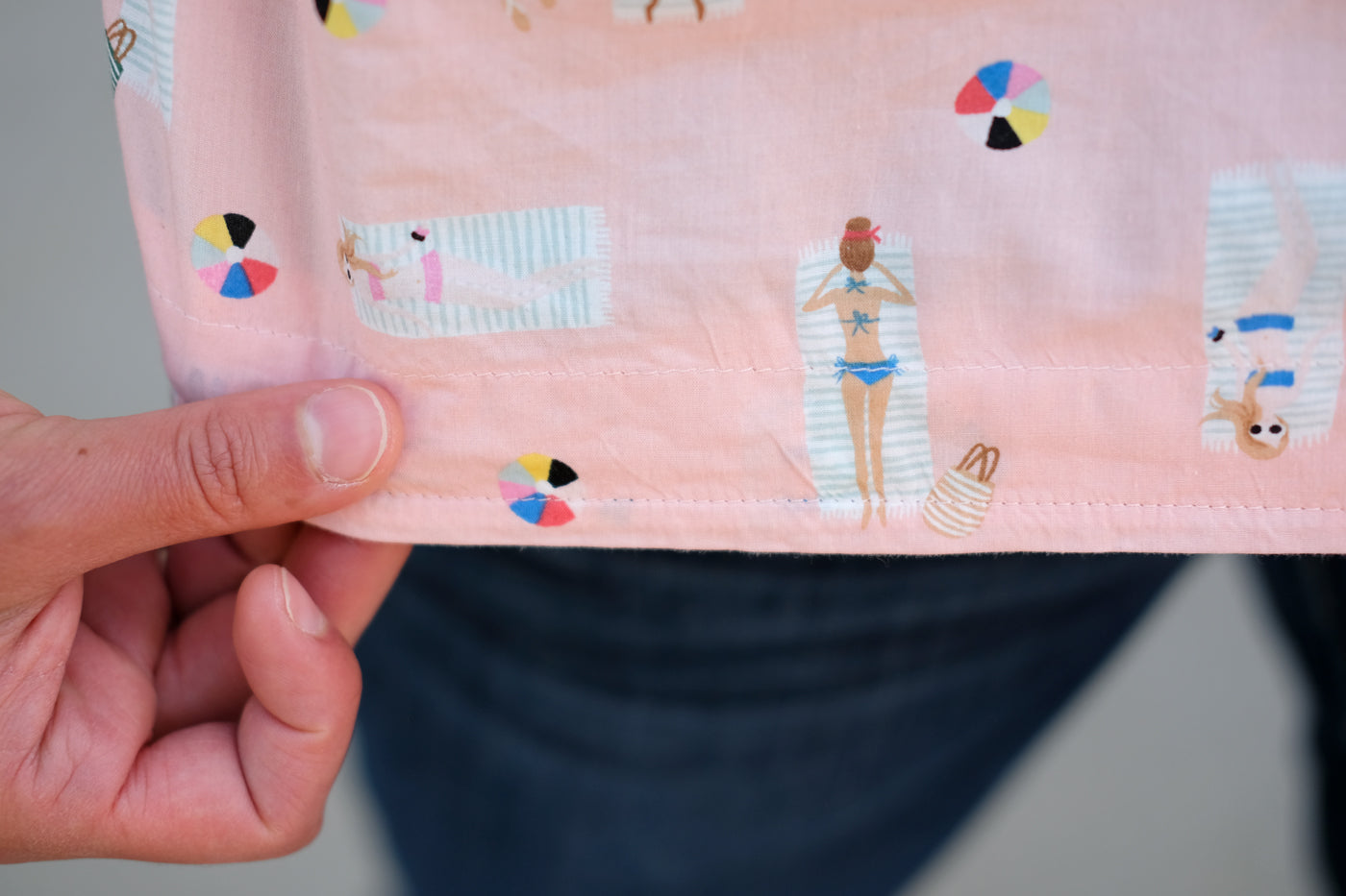 Closeup of the pink bathing women on this Cotton + Steel Fabric