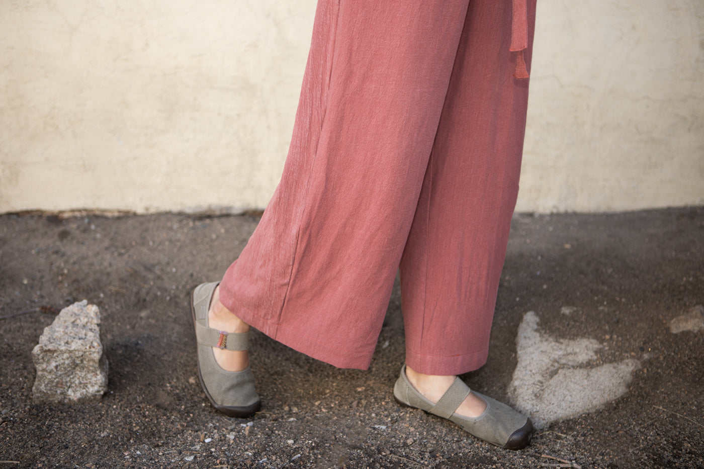 A close up of the legs of the jumpsuit in pink viscose tencel