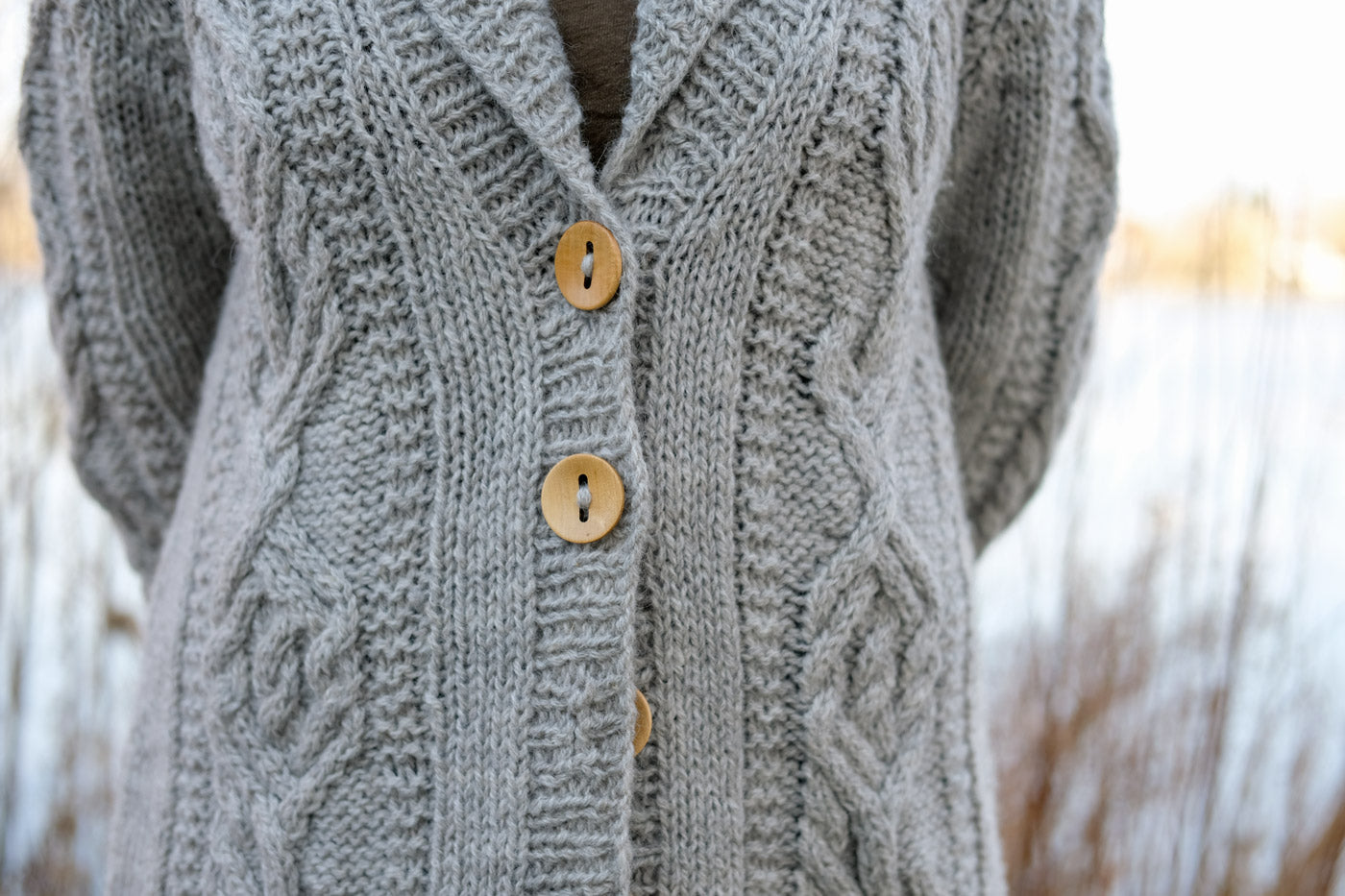 Close up of the oversized collar and button band of Amber's Jungrass Sourcebook Cabled Cardigan