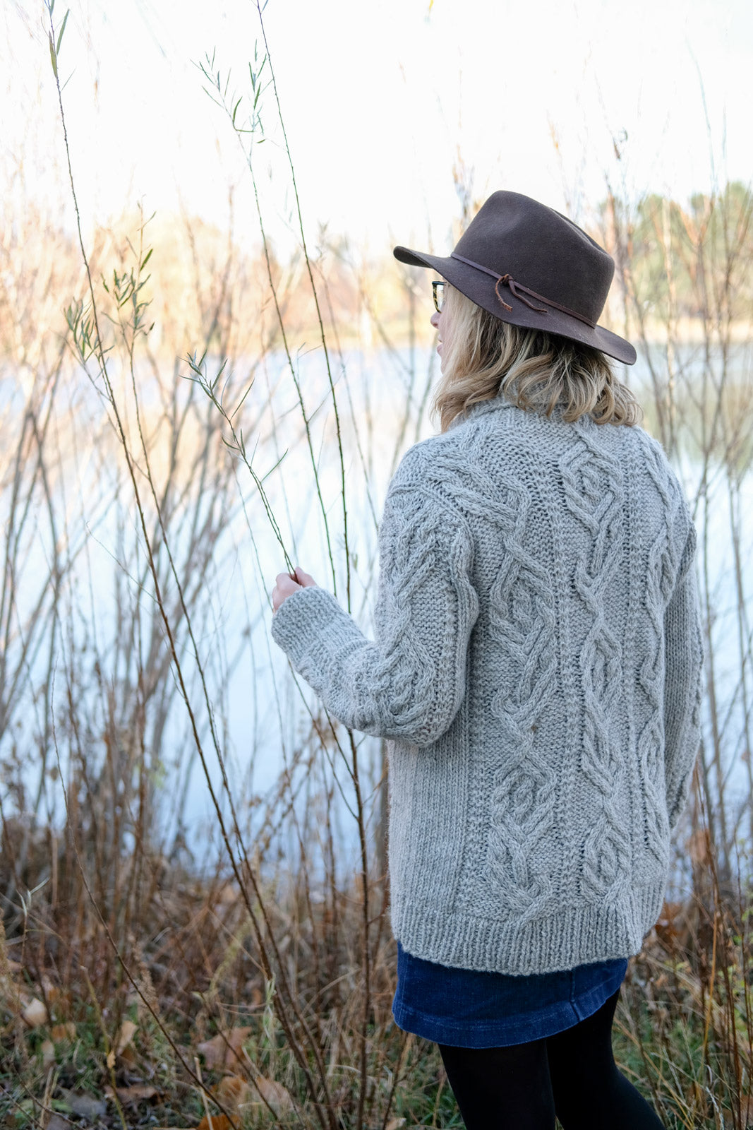 Amber by the water in her cabled Junegrass Cardigan