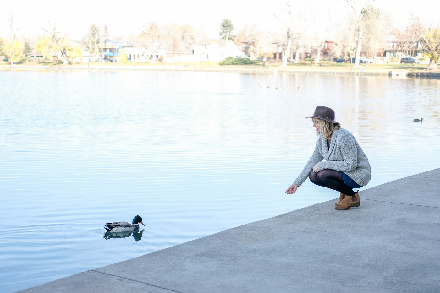 Amber making friends with a duck by the lake