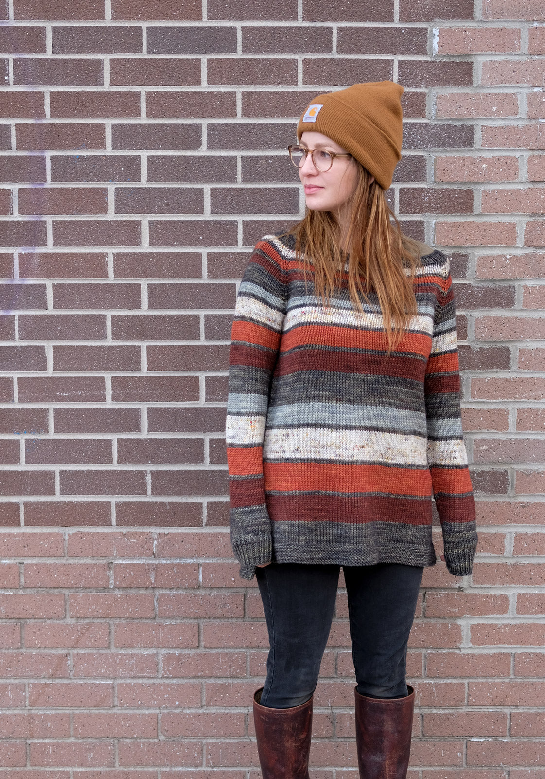 Mary wearing the striped Keystone sweater in front of a brick wall