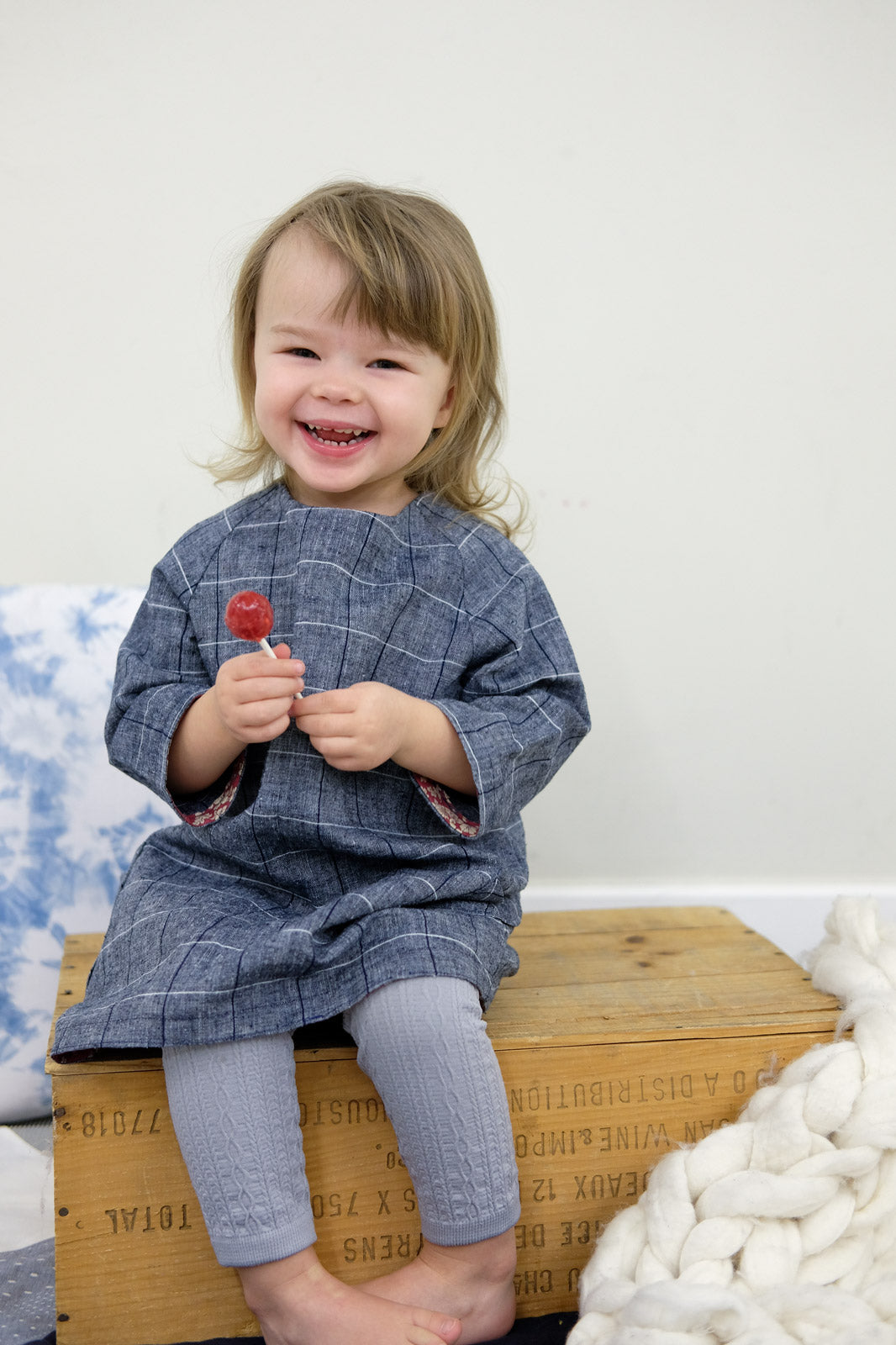 Quinn in her blue windowpane chambray Raglan Dress
