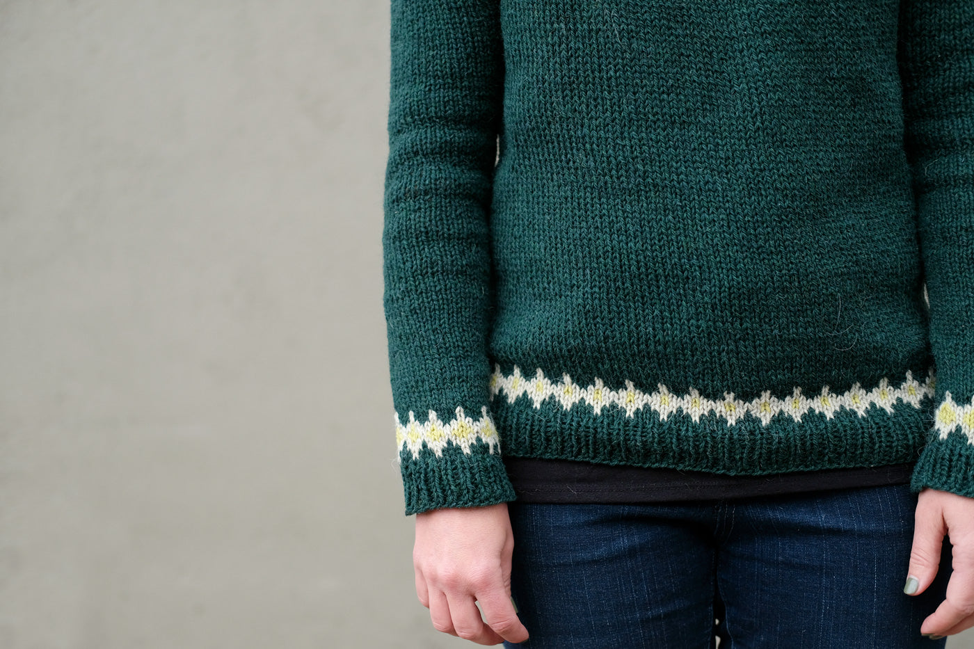 Detail photo of the hemline and cuffs on Jaime's new pullover