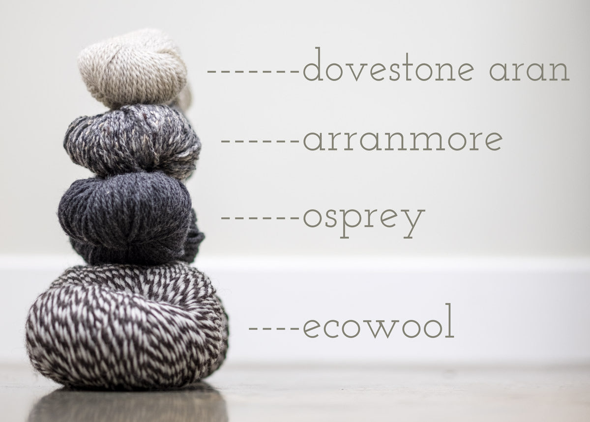 Four skeins of yarn stacked: Dovestone Aran, Arranmore, Osprey and Ecowool