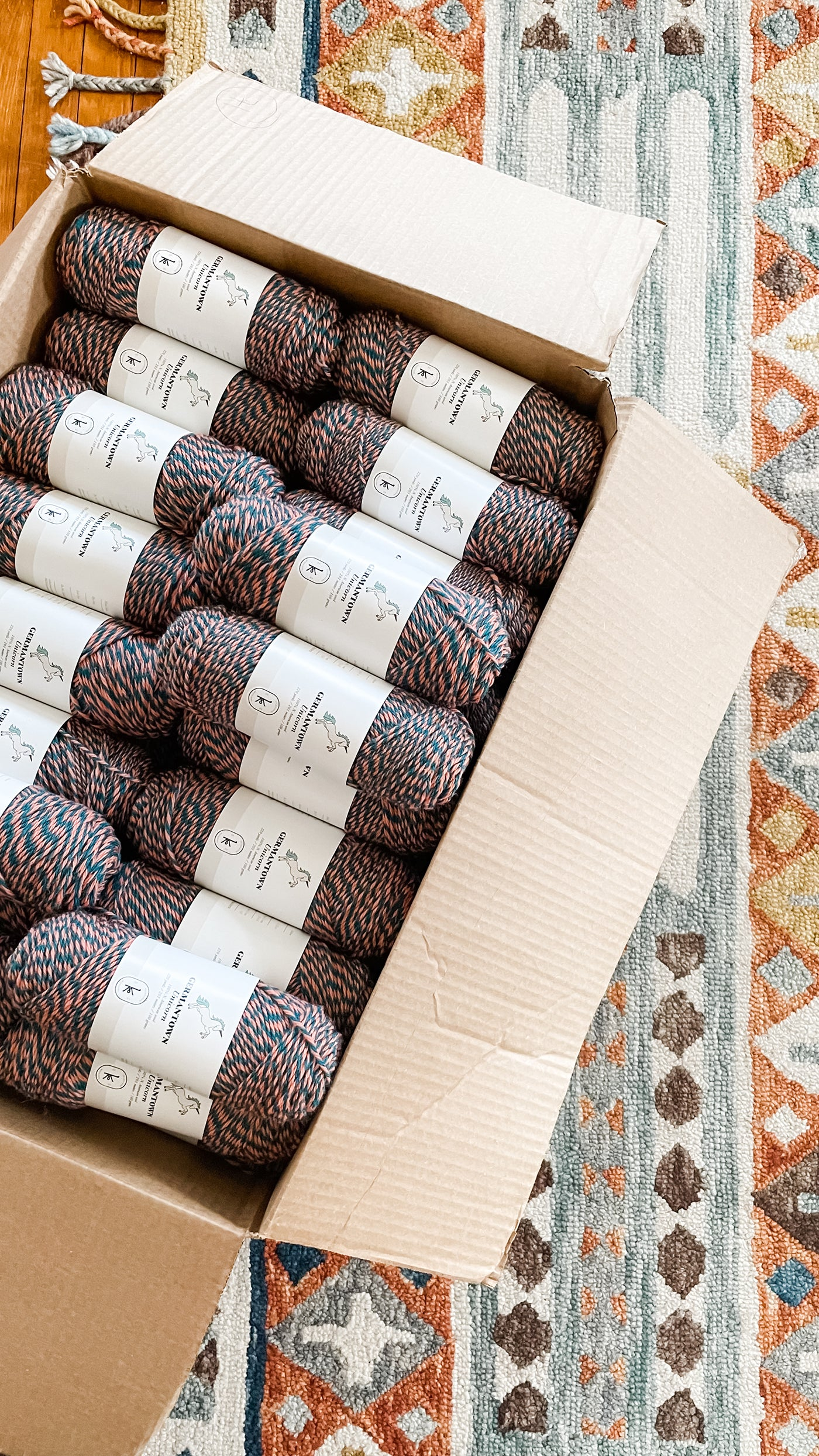 This is an image of a cardboard box full of skeins of yarn.