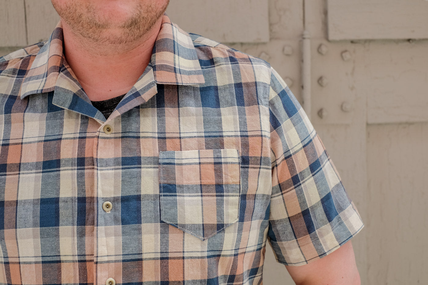Close up of Bob's plaid All State button up shirt