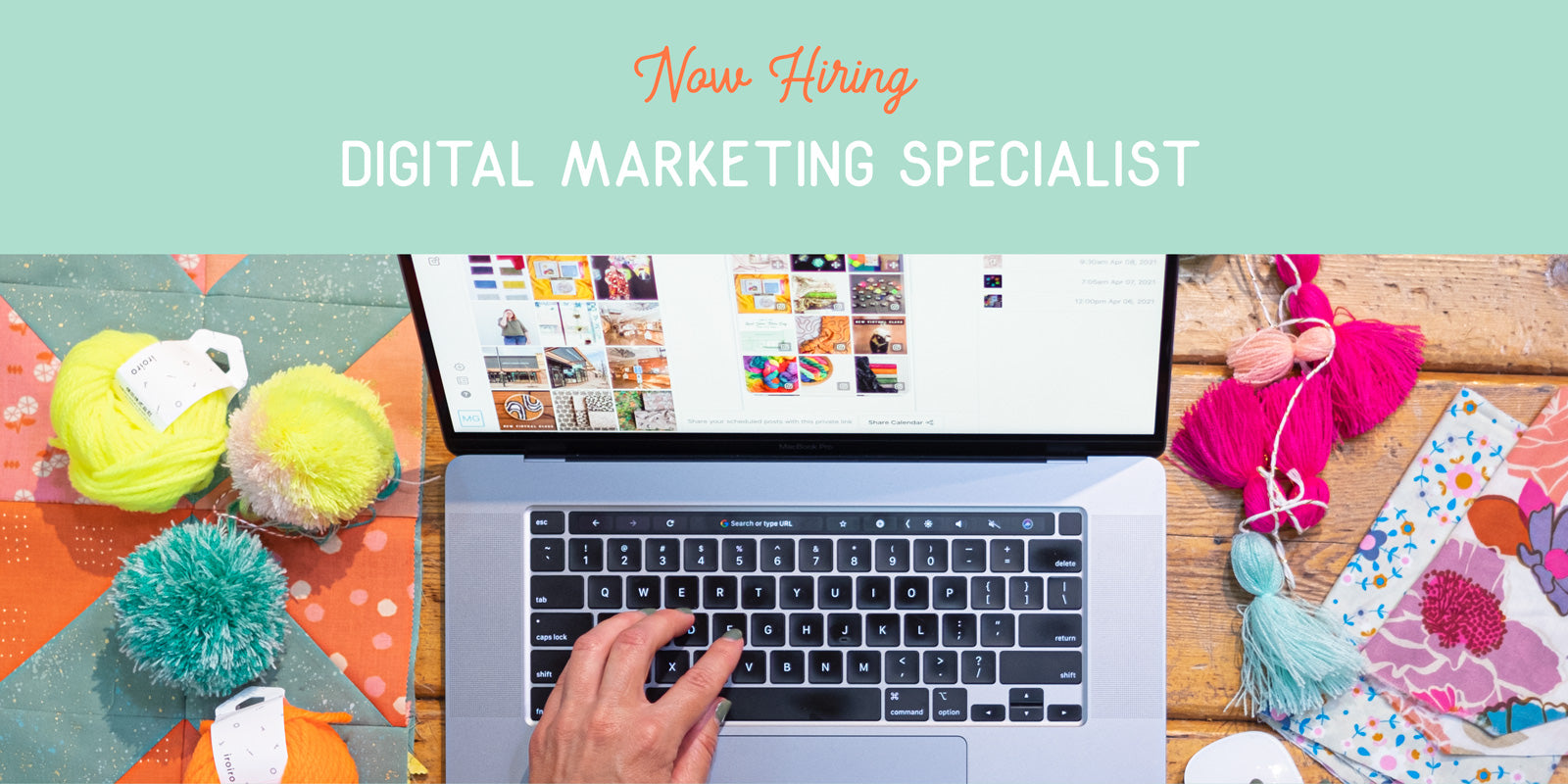 "Image of a macbook laptop surrounded by brightly colored craft supplies, and someones hands are typing on the keyboard. The screen shows they are working on scheduling social media posts. Text above the image says, ""Now Hiring Digital Marketing Specialist"""