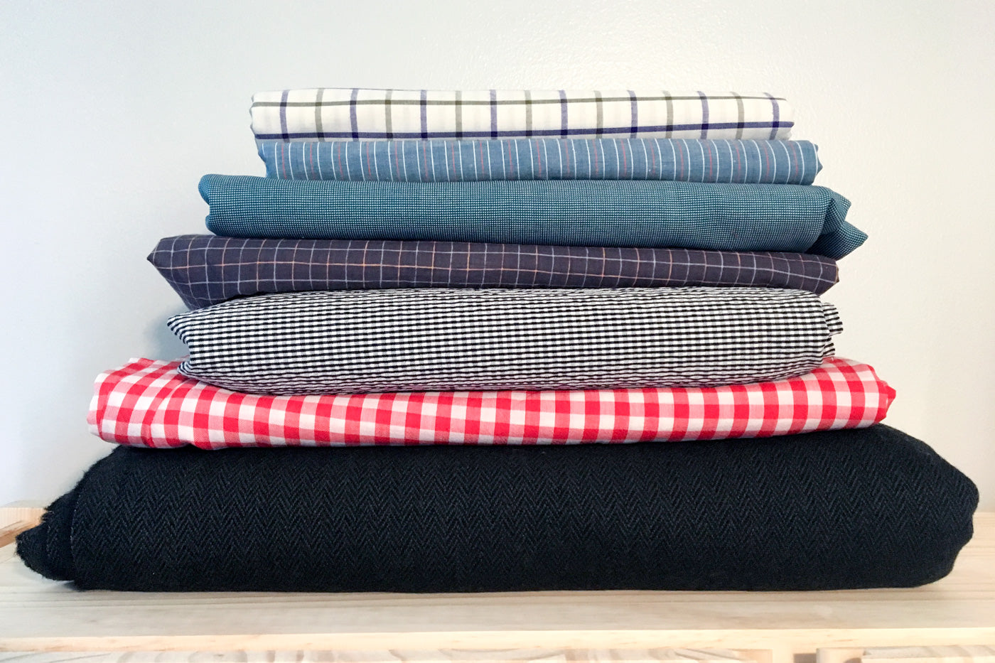 Stack of Wool and Plaid Shirtings