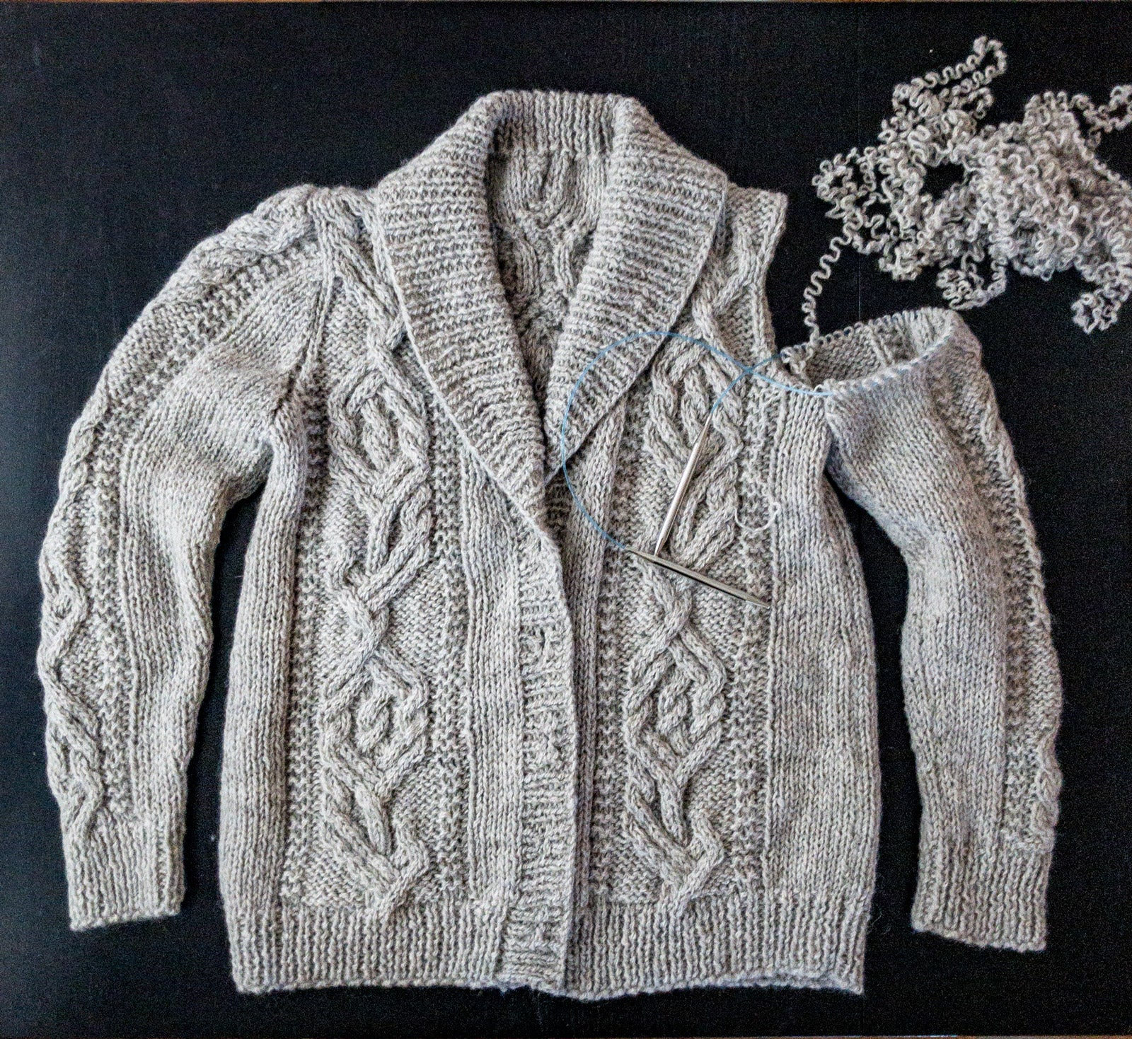 Unraveling the sleeve cap of Jungrass Cabled Cardigan