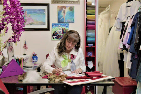 Fashion designer atist Alesia Chaika working on Santa Claus costume inspired by Christmas Chronicles 2 movie at her atelier in Buffalo Grove Illinois USA