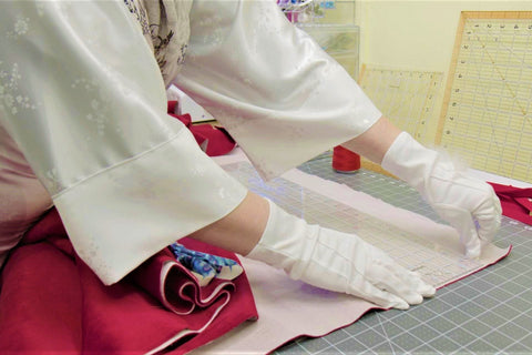 Crafting the traditional Santa Claus costume at Alesia Chaika atelier located in Buffalo Grove, Illinois USA